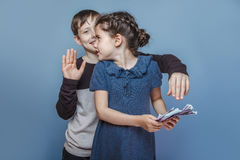 Girl holding money bills in the hands of a boy Stock Photo