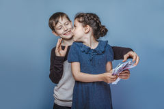 Girl holding money bills in the hands of a boy Royalty Free Stock Photography