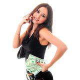 Girl holding money and calling by cell Royalty Free Stock Photos