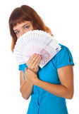 A girl is holding money in her hands Royalty Free Stock Photo
