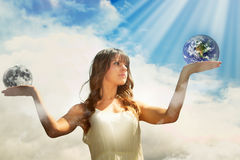 Girl holding moon and earth Stock Photo