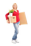 Girl holding a moving box and painting Stock Image