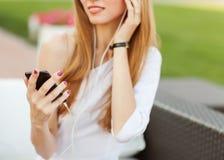 Girl holding a MP3 player Stock Photos