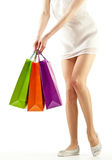 Girl holding multicolored shopping paper bags Stock Image