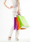 Girl holding multicolored shopping paper bags Royalty Free Stock Photos