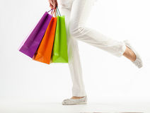 Girl holding multicolored shopping paper bags Royalty Free Stock Image