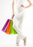 Girl holding multicolored shopping paper bags Royalty Free Stock Photography
