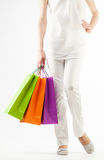 Girl holding multicolored shopping paper bags Stock Images
