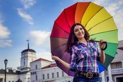Girl holding multicolored umbrella Stock Image