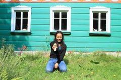 Girl holding mushroom Stock Photo