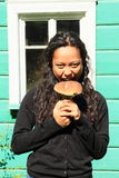 Girl holding mushroom Stock Photography