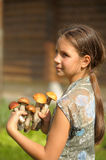 Girl holding  mushrooms Royalty Free Stock Images