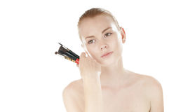 girl is holding near the face make-up brush set. Stock Image