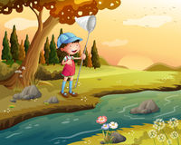 A girl holding a net along the river. Illustration of a girl holding a net along the river Stock Image
