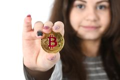 Girl holding new cryptocurrency royalty free stock photography