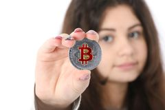 Girl holding new cryptocurrency royalty free stock image