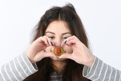 Girl holding new cryptocurrency stock image