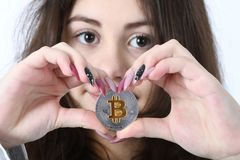 Girl holding new cryptocurrency royalty free stock photo