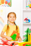 Girl holding New Year card with Xmas tree Royalty Free Stock Photography