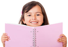 Girl holding a notebook Royalty Free Stock Photos