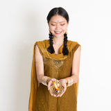 Girl holding oil lamp light Royalty Free Stock Photo