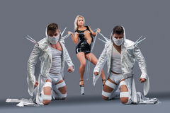 Free Girl Holding On Chain Strong Guys In Masks Royalty Free Stock Photography - 36249147