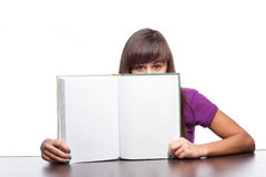 Girl holding open book Royalty Free Stock Images