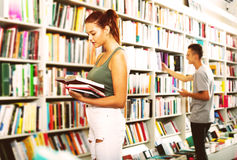 Girl holding open book in hands Stock Photography