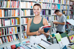 Girl holding open book in hands Stock Image