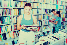 Girl holding open book in hands Royalty Free Stock Photos