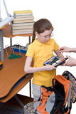 Girl holding open pencil case. By schoolbag royalty free stock photo