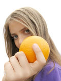 Girl holding orange Royalty Free Stock Photo