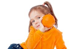 Girl holding an orange Royalty Free Stock Photo