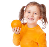 Girl holding an orange Royalty Free Stock Photography