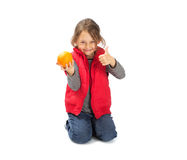 Girl holding a orange Stock Photos
