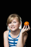Girl holding orange Stock Photos