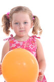 Girl holding orange balloon Stock Images