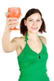 Girl holding orange glass and smiling Stock Photography