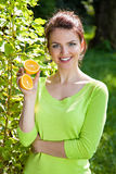 Girl holding oranges in hands Stock Images