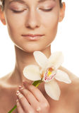 Girl holding orchid flower Royalty Free Stock Images