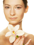 Girl holding orchid flower Royalty Free Stock Image