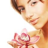 Girl holding orchid flower Stock Images