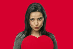 Girl holding oversized heart Royalty Free Stock Image