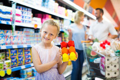 Girl holding package with yogurt Royalty Free Stock Image