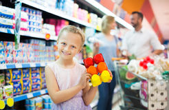 Girl holding package with yogurt Royalty Free Stock Photo