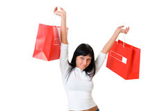 Girl holding packets to the outstretched hands Stock Image