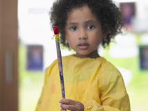 Girl Holding Paintbrush In Art Class Stock Image