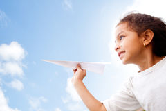 Girl holding a paper airplane Royalty Free Stock Image