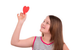 Girl holding a paper heart in hand Stock Images