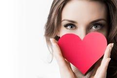 Girl holding paper heart Stock Photos